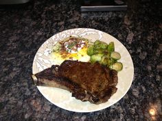 Bone- in grilled Ribeye , pan sautéed Brussels sprouts and loaded mash potato
