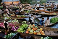 Steve McCurry - MARKET VENDORS ON DAL LAKE, KASHMIR, 1999 | From a unique collection of photography at http://www.1stdibs.com/art/photography/