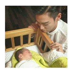 The most beautiful pic ever! TOP and his nephew ❤❤❤❤❤
