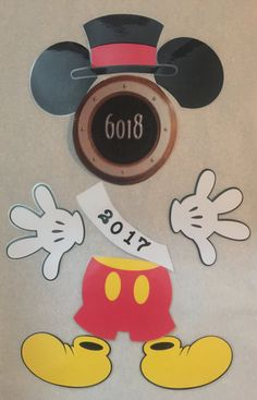 Dress up your Disney cruise stateroom door with this new years Mickey Mouse body part magnet set.  This set includes -party hat -mickey pants -sash -2 hands -2 ears -2 shoes  These are made of cardstock and laminated to make for easy travel. Also have a strong magnet on the back so they stay on the doors without falling off.  These are made to fit around the porthole on the stateroom cruise door of the Disney cruise ships Great for fish extenders or perfect souvenir after cruising to put on…