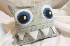 It's a monster! Full tutorial for making a small (6in square) rice bag and monster cover. Heat the rice bag in the microwave and use it to soothe aches and pains, or just to keep your toes warm. Herbs can be added, as well-lavender is great for sleep, peppermint will help soothe upset stomachs, etc.