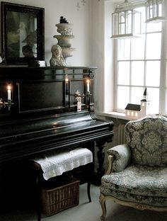 Any space is better with a piano....and a gleaming black one with candelabras, I should feel like the Phantom.