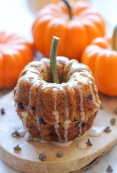 Mini Pumpkin Bundt Cakes with Cinnamon Glaze - These mini bundt cakes are sandwiched together to resemble a sweet baby pumpkin!