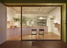 Bakery featuring a tree growing out of its curved timber counter.