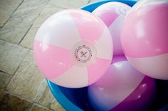 Super cute favor idea with coordinating party sticker!  At this party, they filled the bounce house with them- fun!