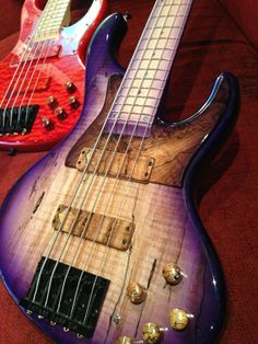 BOSSA OBJ- 5 string bass by Real Bossa Design, Osaka, Japan. RESEARCH #DdO:) - https://www.pinterest.com/DianaDeeOsborne/basses-of-life/ - Info NOT on pins I've seen: This is a semi hollow body. Maple fingerboard. Wilkinson WBG-5 bridge. BOSSA original active circuit. Volume, balancer, bass, middle, treble, halftone-switch. One in purple & yellow stripes wood grain style. One in polished apple red quilt body pattern. Photo pinned via juergenjoherl's FAVORITE CUSTOM JAZZ BASSES #Pinterest…