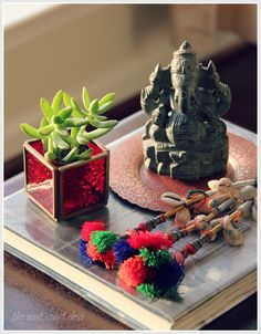 A hand chiseled Ganesha from Mahabalipuram looks happy in the company of a vibrant tassle and a new succulent (housed in my votive holder from World Market turned pot holder). (Image : Sruthi singh - the east coast desi blogspot)