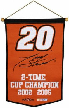 "Tony Stewart 2 Time Champion Wool Banner by Mounted Memories. $14.99. Mounted Memories is excited to launch our Racing Collection of Wool Championship-Style Banners! These high quality banners measure 36"" tall x 23.5"" wide, are made of 70% wool and 30% acrylic blend material and come with a wooden dowel and rope for hanging. All of the logos are embroidered with the utmost detail. Proudly display your driver allegiance with a Mounted Memories Racing Collection Wool Banner."