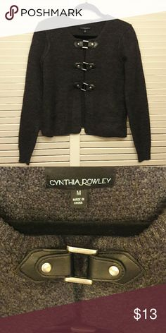 Cute sweater Cute dark gray sweater. Sweater has faux pockets and cute buckle style closures on the front. Sweater is too short for me. Cynthia Rowley Sweaters Cardigans