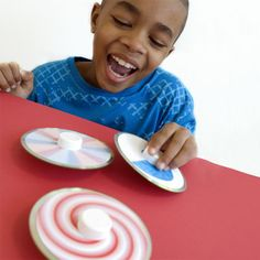 CD spinning tops - tutorial.  Use an old CD, plastic bottle top for handle and marble to make it spin. Includes templates.