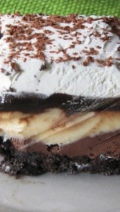Copycat Dairy Queen Ice Cream Cake ~ Better than any DQ cake I've ever had, and it's much cheaper too! The homemade fudge layer is so yummy, and you can customize it with your favorite ice cream, etc. Makes a 13 X 9 pan-full of frozen goodness!!