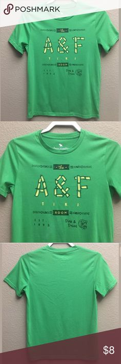 """Boys Abercrombie Kids Short Sleeve T-Shirt Boys Abercrombie Kids Short Sleeve T-Shirt in great condition with no stains or holes  Colors are Green and Yellow  60% Cotton and 40% Polyester  Approximate measurements taken laying flat  Armpit to armpit 17"""" length 24"""" Arrives clean and ready to wear from a smoke free environment abercrombie kids Shirts & Tops Tees - Short Sleeve"""