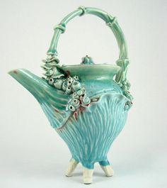 Unique Mermaid Skeleton Key Sci-Fi Garden Turquoise Skull Teapot with Feet. $130.00, via Etsy.