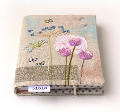 notebook with embroidered cover...