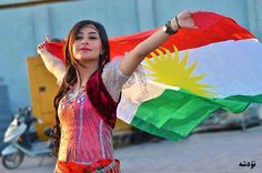 Beautiful young lady celebrating a flag day in Kurdistan