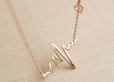 She'll know she makes your heart beat faster with this heart rhythm necklace from Daniel Monogram Design. Discover more unique jewelry from wootandhammy.com.