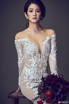 Sexy off shoulder wedding dress with plunging neckline