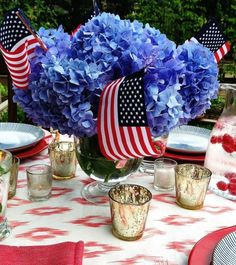 So pretty, so simple. Just arrange a handful of blue hydrangeas in a glass vase, and place small flags throughout.