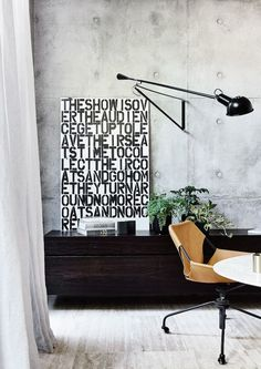 """A striking modern industrial style Melbourne home by builder/owner Agushi and architect John Bornas of Workroom … """"The modern form of this home is comprised of a large white cement rendered box atop a ground-floor of glass and off–form concrete. The use of raw industrial materials such as off-form concrete and steel compliments thetimber paneling …"""