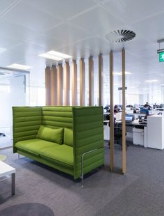 This cool, green high-back and high-side seating booth is ideal for informal meetings away from the open plan. Timber struts create a partition between this meeting area and the open plan office space.