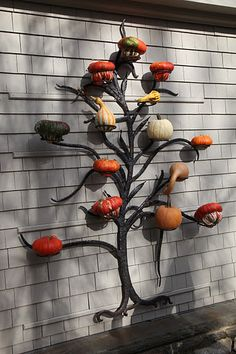I've always loved this cast-iron tree Martha has. So many fun, seasonal displays you can do with it...