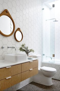 Hex tile bathroom, mid-brown cabinets and in-bath shower