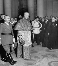 Generalissimo Franco (L) paying a formal visit fo Papal Legate Tedeschini.
