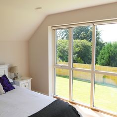 Modern master bedroom with white wall, timber flooring and large bedroom window. Building a house, by Potton, Self-Build Specialists Tile Bedroom, White Wall Bedroom, Modern Master Bedroom, Modern Bedroom Decor, Trendy Bedroom, Bedroom Flooring, Bedroom Ideas, Large Bedroom, Interior Windows