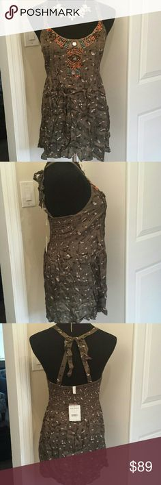 NWT Free People Open Back Beaded Dress Gorgeous olive colored free people dress with unique beaded front. Back ties in a bow for super cute unique look. Brand new with tags. amazing for summer spring and fall if paired with skinny jeans or leggings. Free People Dresses Mini