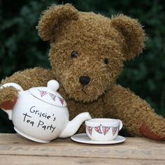 teddy bear's picnic. The ultimate little girl's tea set. This exquisite ceramic set includes a beautiful teapot personalised with the child's name. All pieces feature our Union Jack bunting and include two cups and saucers, two plates, a sugar bowl, milk jug and the personalised teapot. The set comes in a beautiful wicker hamper.  Teddy not included.