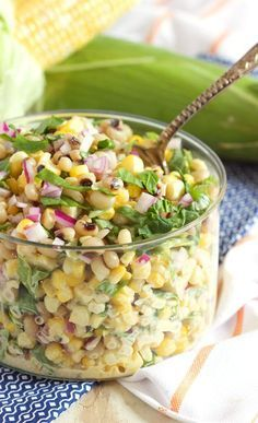 This super easy summer salad recipe is loaded with fresh, sweet corn, black-eyed peas and spinach before being tossed with a creamy dressing with a kick! | /suburbansoapbox/