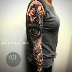 Realistic eye tattoo sleeve by Olga Dolganowa