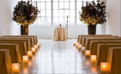 Using candles is another way to make the aisle beautiful without going too much into the traditional styles. The example here looks particularly modern because it lacks any other aisle decor.
