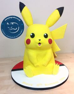 3D Pikachu cake, made by The Foxy Cake Co!