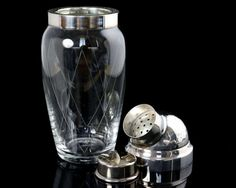 Vintage cut lead crystal cobbler cocktail shaker with silver-plated mounting. The lids feature hammered finish. The cocktail shaker body is mouth-blown of lead crystal, the decor is hand-polished.  Made in West Germany.  Gorgeous bar accessory. Height with the lid: 210 mm (8.27)  Weight: 425 g (0.94 lb)  In good vintage condition. The lid has one round dent on the lid (seen in the pictures). Please take a moment to analyze the pictures for more details…