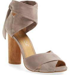 Bold suede straps wrap this block-heel sandal that goes with just about everything in the wardrobe.
