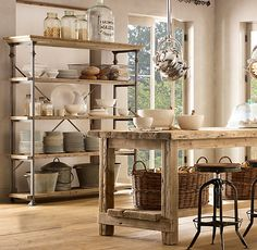 I love everything in this photo.  Restoration Hardware.  Bakers Rack 2195. Barstool 345. Pool locker baskets (In the Baker's rack top shelf) 39/59.