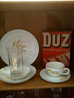 """In the early 1950s, Procter & Gamble introduced a powdered laundry detergent  called """"Duz"""" claiming, """"Duz does Everything!"""" and worked even in the hardest water. It was the company's promotional gimmick, though, that got my mother interested: they were offering a set of free china! One dish item, white with a golden wheat pattern and gold edging, would be placed in each box of Duz, eventually providing the loyal shopper with the complete set of china dishes, good enough for company."""