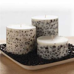 Add an aesthetic and aromatic touch to homemade candles by embedding coffee beans.
