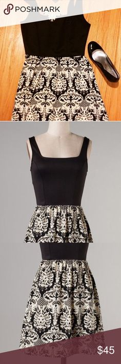 Damask and Black Sleeveless Dress Brand New damask print dress with a solid black scuba fabric top. Sleeveless, square scoop neck. Polyester flowing skirt. Cream and black. True to size. A-line or perhaps closer to a skater style skirt. Dresses Mini