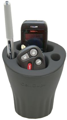 Cup accessory holder... (don't leave your keys in the car) But clever organizer.