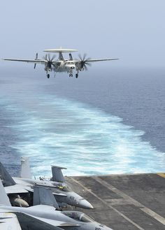 """GULF OF OMAN (June 25, 2013) An E-2C Hawkeye assigned to the """"Wallbangers"""" of…"""
