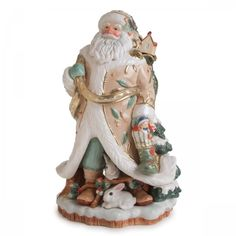 The Winter Wonderland Collection is elegantly designed with pastel green and cream colored backgrounds, with touches of gold trim to add an extra layer of sophistication.  The large Santa Figurine is the focal point of the collection, and has long been a customer favorite.  Carrying his sack of toys, with bunnies playing at his feet, the Winter Wonderland Santa Figurine is a stunning addition to your holiday decor!