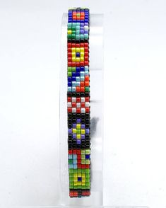 This bracelet is made out of tiny Japanese Miyuk Loom Bracelet Patterns, Bead Loom Bracelets, Bead Crochet Patterns, Beading Patterns Free, Loom Bands, Making Bracelets With Beads, Unisex Gifts, Loom Beading, Bead Art