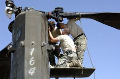 U.S. Army Soldiers from 3rd Battalion, 10th Mountain Aviation Regiment, 10th Mountain Division do last adjustments to the bonding of a CH-47 Chinook helicopter blade during maintenance work at Bagram Airfield, Afghanistan, June 12, 2006