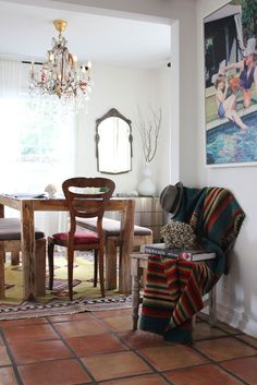 I love the combination of dainty chandelier and rustic table.