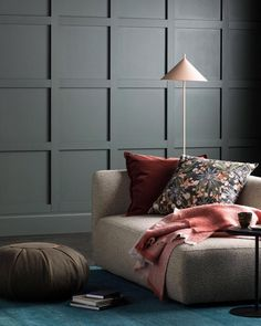 Be right back… We'll be full blown cocoon-mode here with a good read and a cup of tea! Colour used is Haymes Black Olive. Photography by Styling by House Paint Exterior, Interior And Exterior, Rugs In Living Room, Living Spaces, Room Rugs, Blue Feature Wall, Interior Paint, Interior Design, White Bookshelves