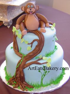 Two tier unique blue fondant kid's birthday cake with tree and 3D monkey