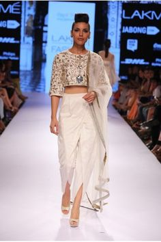 Payal Singhal Indian Wear Collection : : Zubaida Dhoti Set : Ivory Dupion Silk Crop Top With Zardosi & Leather Applique Embroidery Worn With Dhoti Pants & Tulle Dupatta. Dhoti Saree, Lehenga Choli, Saree Gown, Salwar Kameez, Indian Fashion Trends, Asian Fashion, Indian Fashion Modern, Women's Fashion, Indian Dresses
