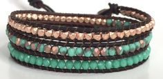 This Three Wrap Bracelet has a Wrap each of Matte Green Turquoise Apollo Fire Polished Beads